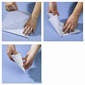Spritzbeutel aus Pergamentpapier falten
