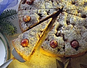 Chestnut and cherry cake with icing sugar
