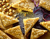 Filled nut triangles with caramel icing