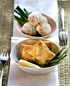 Dim sum: deep-fried pastry parcels, rice balls behind