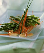 Green asparagus with pepper strips on a plate