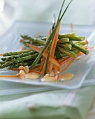 Green asparagus with strips of pepper in bowl