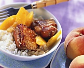 Duck curry with honey, peaches and rice