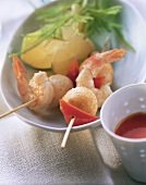 Colourful shrimp kebabs with dip