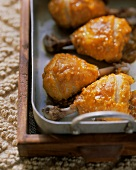 Exotic chicken thighs with sesame in roasting dish