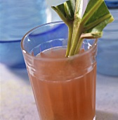 Rhubarb cooler with stick of rhubarb in the glass