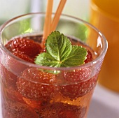 Strawberry punch with strawberry leaf in glass