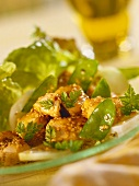 Spring salad with chicken fillet, sesame and mangetouts
