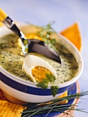 Spring herb soup with boiled egg