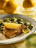 Minute steaks with spinach gnocchi, with lemon wedge