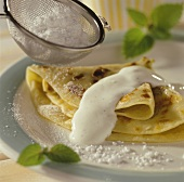 Rhubarb pancakes with vanilla yoghurt and icing sugar