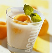 Apricot buttermilk drink with mint leaf