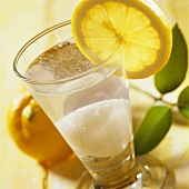 Ice cream shake with lemon slice on the edge of the glass