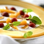 Cold kefir soup with apricots, raspberries and lemon balm