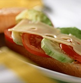 Baguette roll with cheese, tomatoes and cucumber