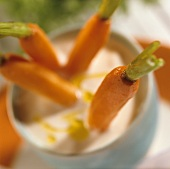 Four fried carrots with sour milk dip