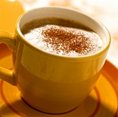 Children's cappuccino in a yellow cup