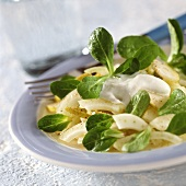 Fennel and pear salad with corn salad and sour cream