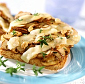 Mushrooms on toast with walnuts, cheese & thyme leaves