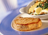 Veal steak with spinach and potato gratin
