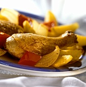 Grilled chicken dish with potatoes and peppers