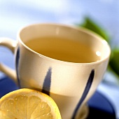 Herb tea with lemon in blue and white cup
