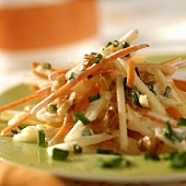Carrot and apple salad with nuts and chives