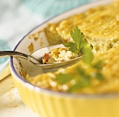 Potato and vegetable tart with parsley in baking dish