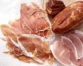Various types of ham: raw and boiled ham, bacon