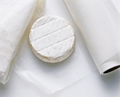 Soft cheese in greaseproof paper packing