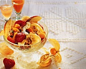 Muesli for dietary fibre with fruit & yoghurt in glass bowl