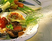 Steak with vegetable rice in fennel bowl and grilled tomato