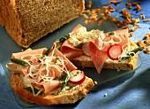 Sauerkraut bread with ham, radishes and sauerkraut
