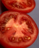 Two tomato halves side by side