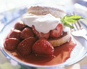 Strawberry tartlets with cream on plate