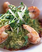 Pea risotto with scampi and watercress
