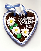 October Festival gingerbread heart with blue and white bow