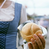 Hand holding a fish roll at the October Festival