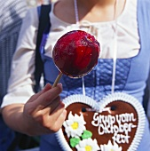 Woman with love-apple & gingerbread heart at Oktoberfest