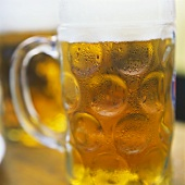 Cold light beer in a tankard