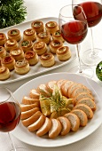Salmon pate and puff pastry tartlets; red wine