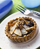Tartlets with various fruits and walnuts