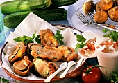 Courgettes with tomato quark in beer batter, boiled potatoes