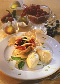 Mango mousse with fruit salad in baked strudel pastry
