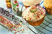 Decorating muffins with sugar pearls and shapes
