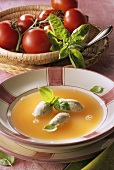 Clear tomato soup with dumplings and basil