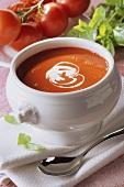 Cream of tomato soup in white soup tureen