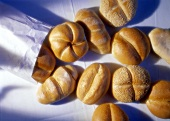 Various bread rolls from a paper bag