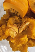 Pumpkin puree with garlic cloves and pumpkin quarters