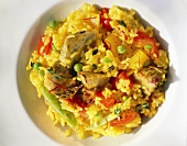Vegetable paella with artichokes, tomatoes & peas